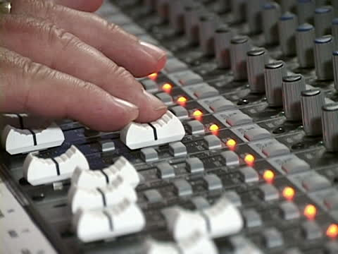 person on mixing board